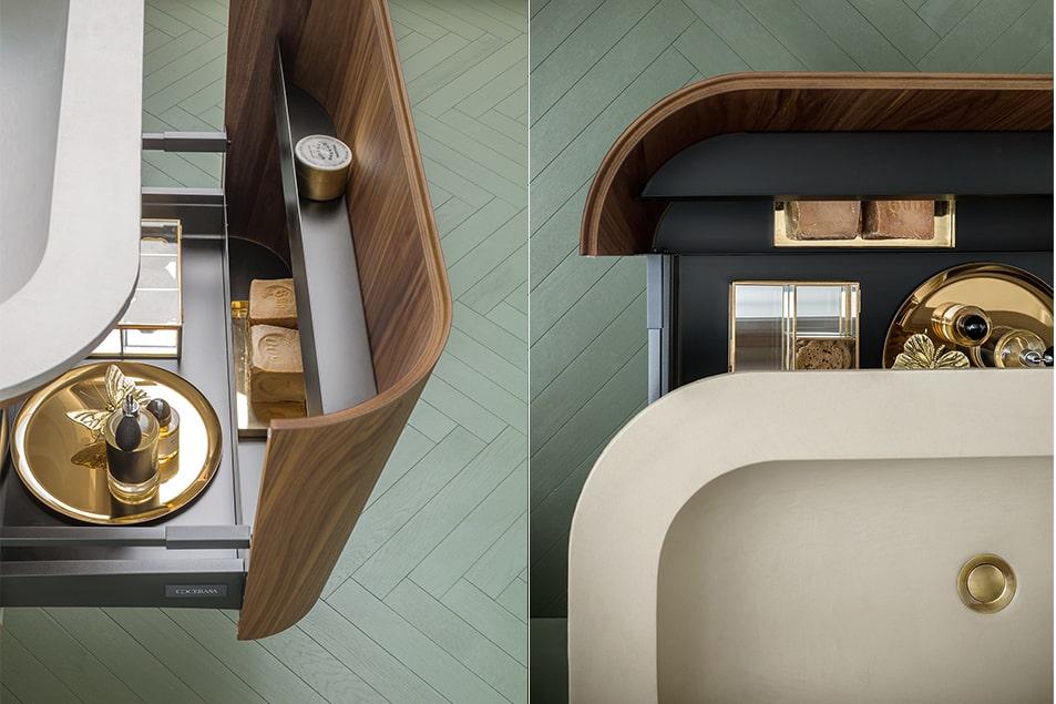 Ampio cassettone sotto il lavabo con mensole porta oggetti all'interno del frontale