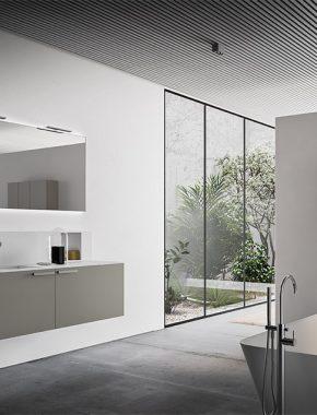 Ampia base lavabo sospesa con ante laccate lucide e maniglia laccata