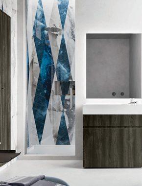 Base lavabo a terra Single in nobilitato Dogato Wood su cui poggia il lavabo Unica in Solid Surface.